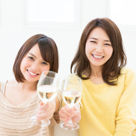Two Asian girls with a glass of wie